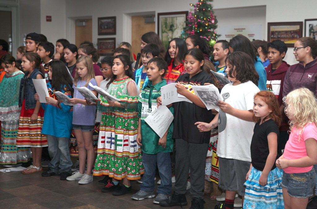 PECS students sing Christmas carols in Creek for children from the Real Life Children's Ranch on Dec. 6. (Beverly Bidney photo)