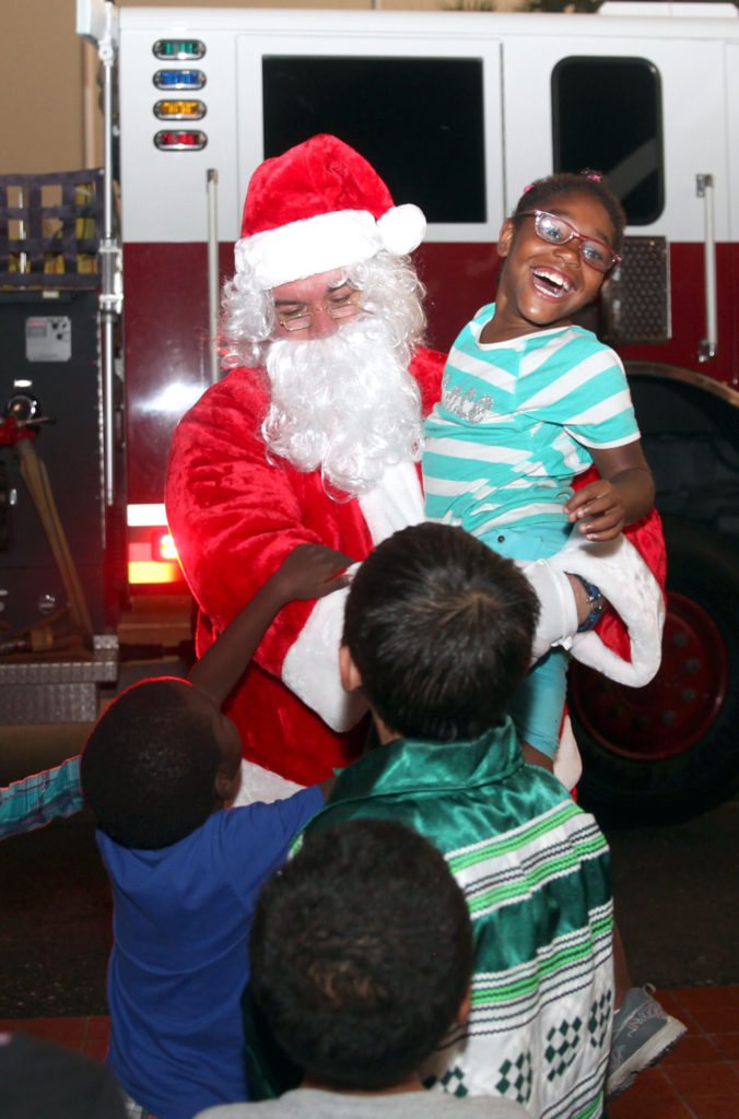 Santa visits PECS as it hosted kids from the Real Life Children's Ranch for a Christmas party.(Beverly Bidney photo)