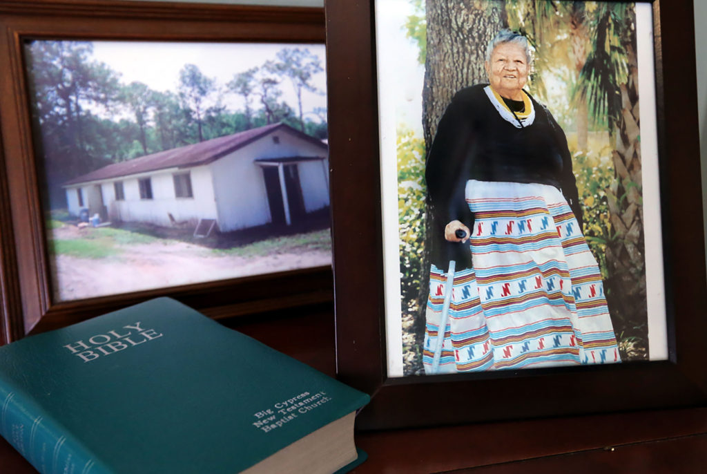 In the vestibule of the Big Cypress New Testament Baptist Church are photographic reminders of the 50-year-old church's humble beginnings as a plain wooden building and of Eddie Cypress Billie who was the wife of the church's founder and first leader Frank Billie.