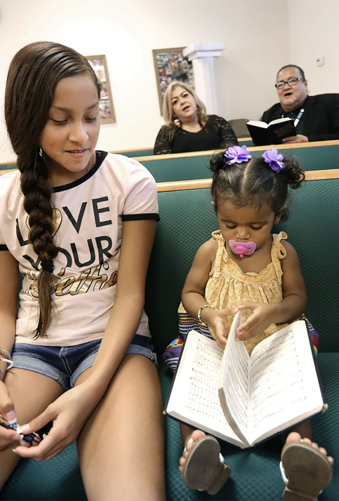 Young and young at heart lift their voices in song Dec. 3 during the 50th anniversary celebration service at Big Cypress New Testament Baptist Church.(Eileen Soler photo)