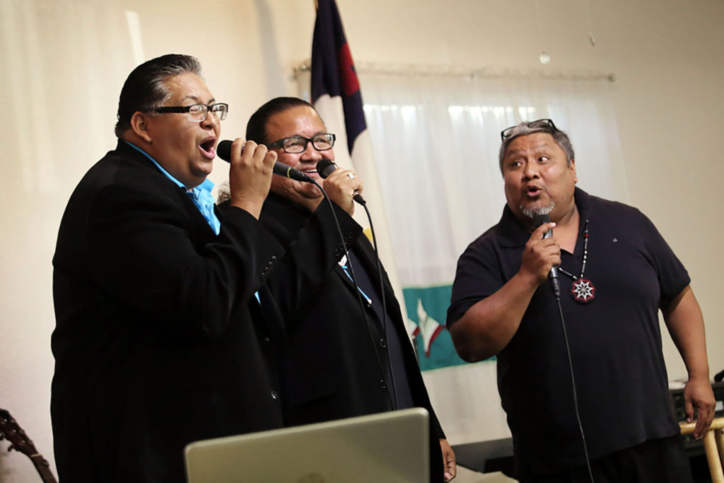: Members of The Master's Touch, Devon Fobb, Bruce Redbird and Henry Battiest Jr. belt out one of several gospel hymns during a performance Dec. 3 at Big Cypress New Testament Baptist Church.(Eileen Soler photo)