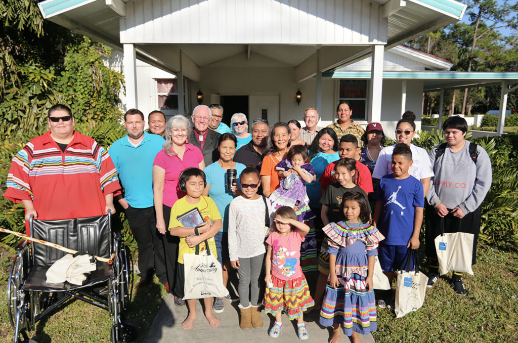 At Big Cypress New Testament Baptist Church's 50th anniversary celebration Dec. 3, members and guests pose in front of the sanctuary built a half century ago. (Eileen Soler photo)