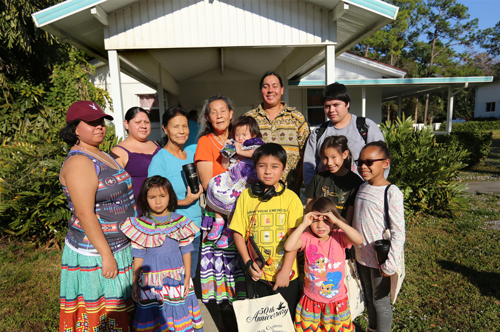 : Janice Osceola (center) and loved ones pose for a portrait outside of Big Cypress New Testament Baptist Church on Dec. 3 after a celebration service marked the church's 50th anniversary. (Eileen Soler photo)
