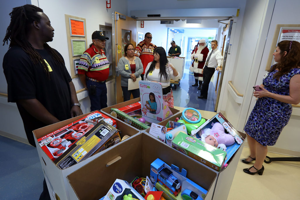 : Seminole Tribe representatives and staff from Joe DiMaggio Children's Hospital gather Dec. 6 with Santa Claus for a surprise holiday toy delivery to sick children. (Eileen Soler photo)