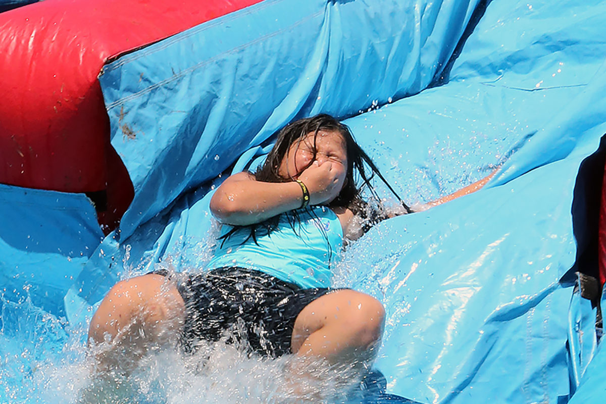 Some kids did brave the giant water slides, such as this girl who held her nose as she neared the end of the slide. (Damon Scott photo)