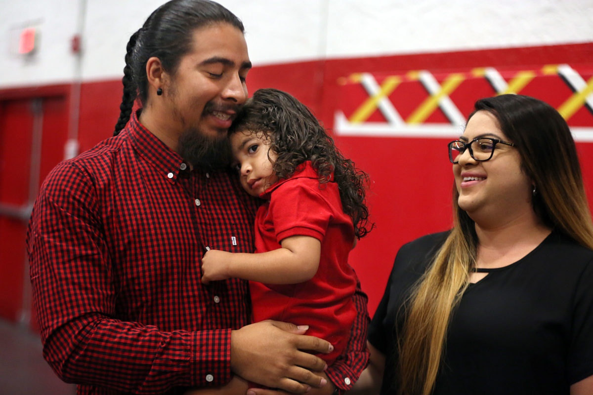 Quenton Cypress is a happy dad as he holds his daughter Willow, 2, as Maria Vargas looks on at the BC Father's Day celebration.  (Beverly Bidney photo)