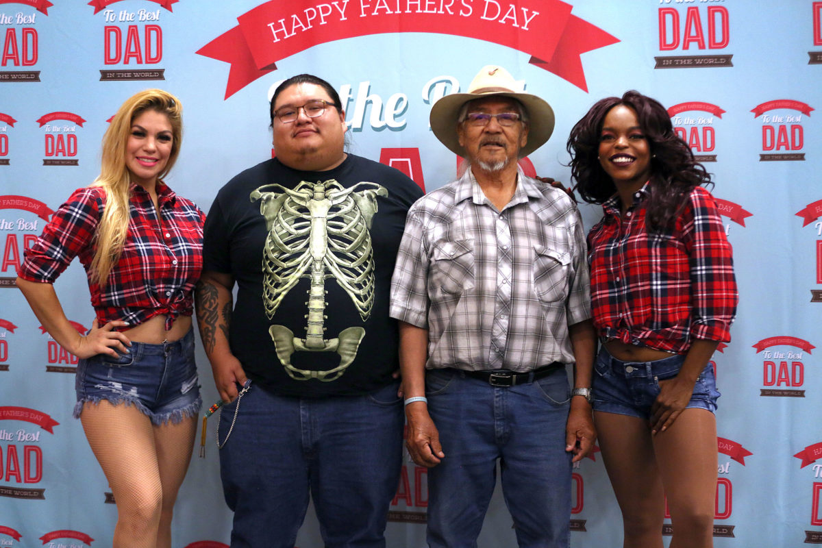 Daisy Duke Dancers pose with Rowdy Osceola and his grandfather Rudy Osceola at the BC Father's Day soiree. (Beverly Bidney photo)