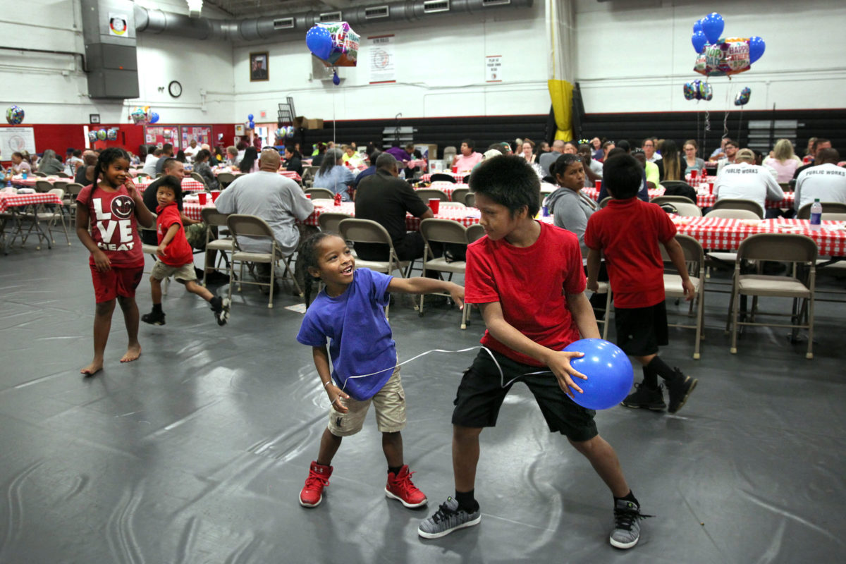 Children play at the BC Father's Day luncheon.  (Beverly Bidney photo)