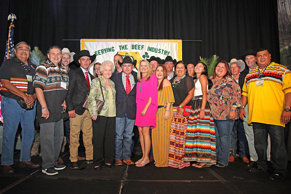 Tribal members, staff and members of the Brighton community pose with Alex Johns, the newly named president of the FCA. (Beverly Bidney photo)