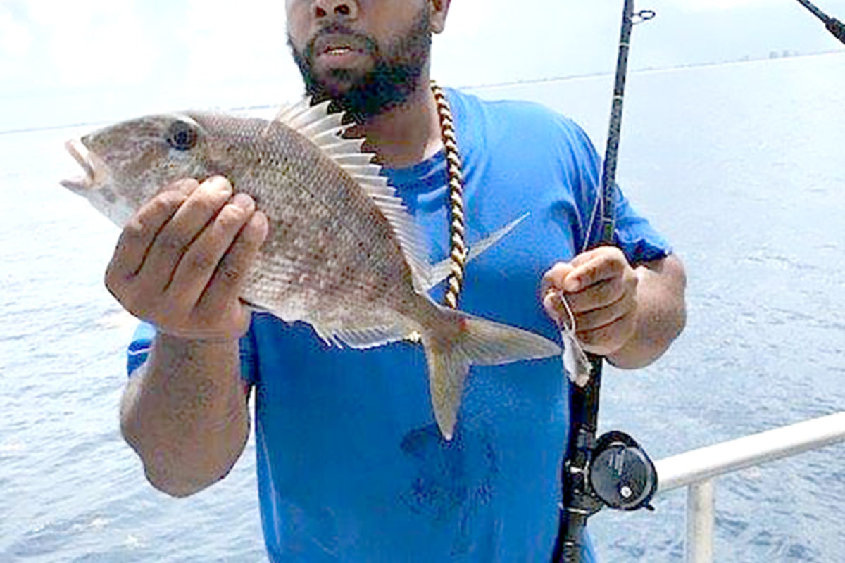 Joshua Sneed shows off the fish he caught during the Fort Pierce Father's Day chartered fishing trip off the coast of Riveria Beach.  (Courtesy photo)