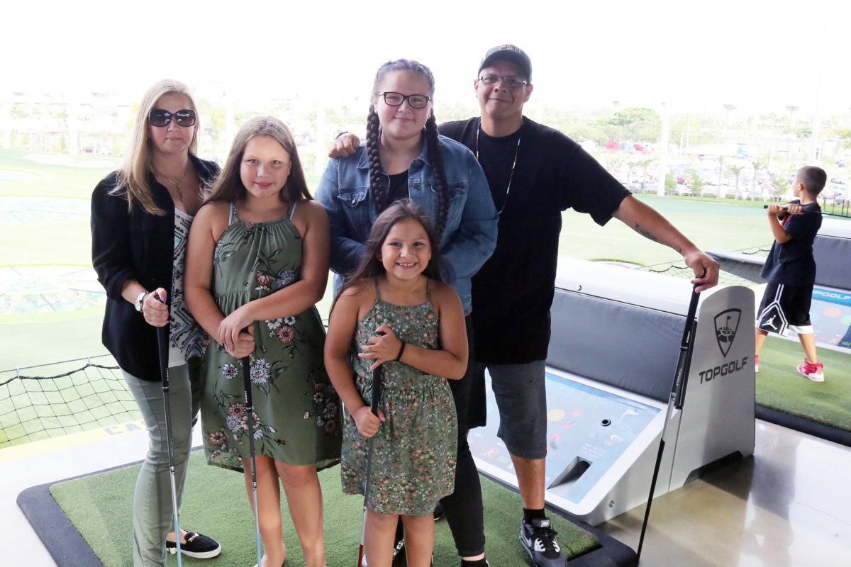 The Holata family took part in the Hollywood Father's Day celebration at Topgolf in Miami Gardens June 14. From left to right are Felicia, Maycee, Shyla and Jay. Auynn, the youngest, is in front. (Damon Scott photo)