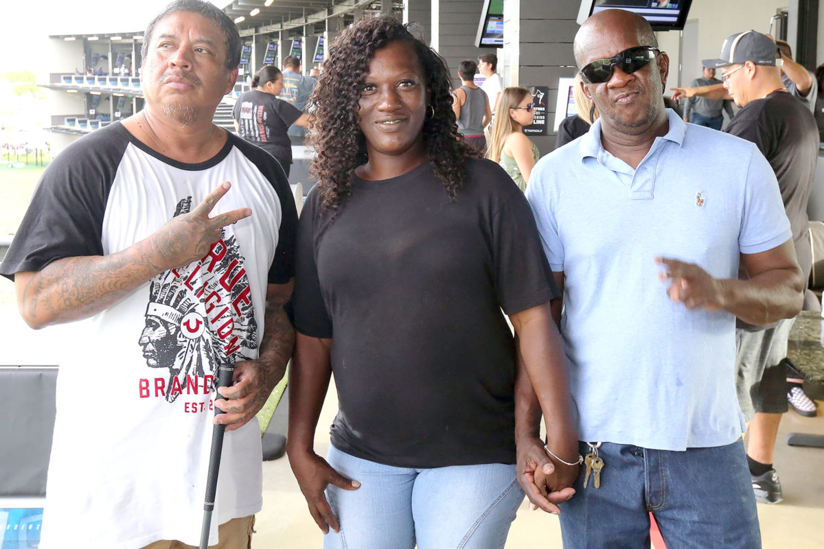 Family and friends of the honored guests – fathers – came to enjoy some golf, food and fun. Angelo Osceola, left, is pictured with two of his friends – Chenell Dickerson and Nathan Freeman. (Damon Scott photo)