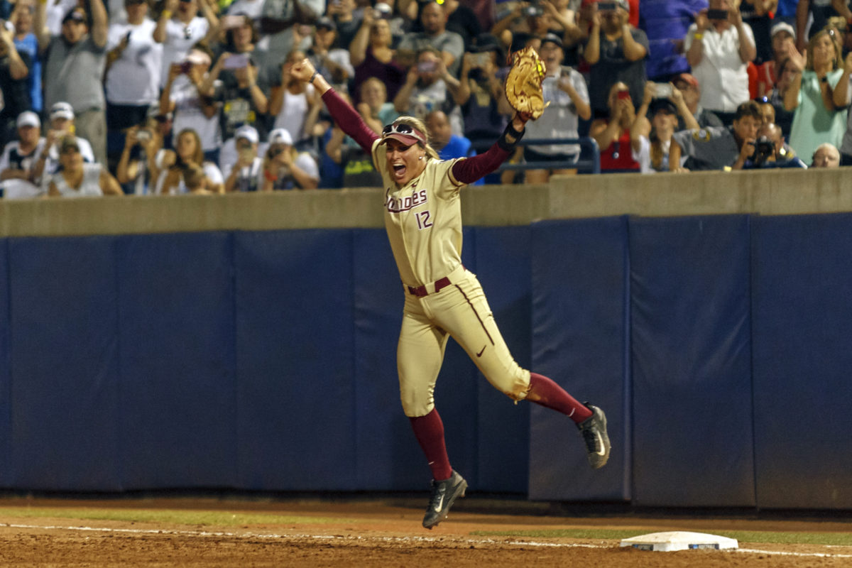 Carsyn Gordon rejoices after making the last out to mark the Seminoles first WCWS win.