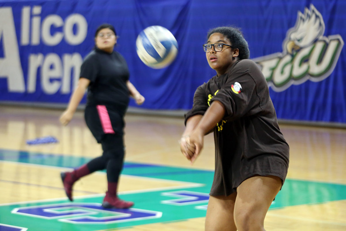 Jordan Osceola returns the ball as Thomlynn Billie watches during the FGCU volleyball clinic June 9 at the Fort Myers campus. (Beverly Bidney photo)