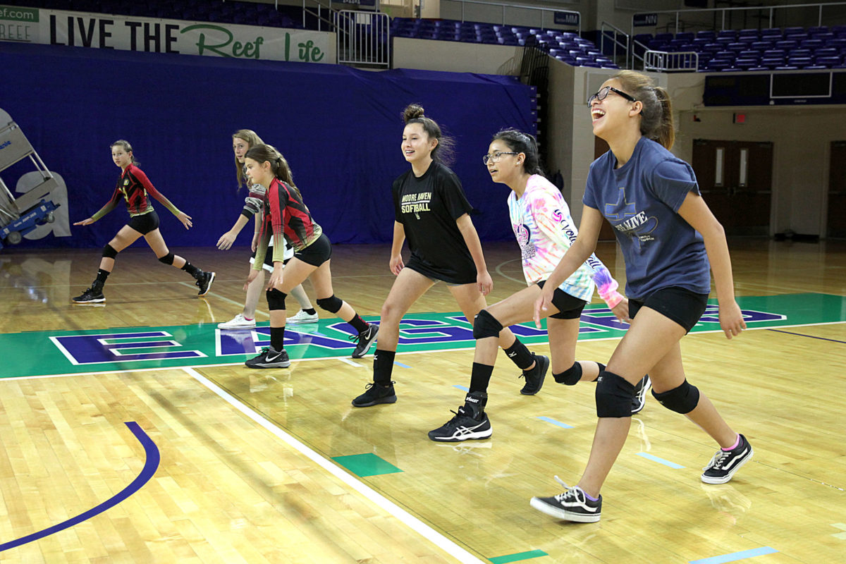 The footwork drill brought out the giggles for some of these girls, who attended the volleyball clinic to improve their skills.  (Beverly Bidney photo)