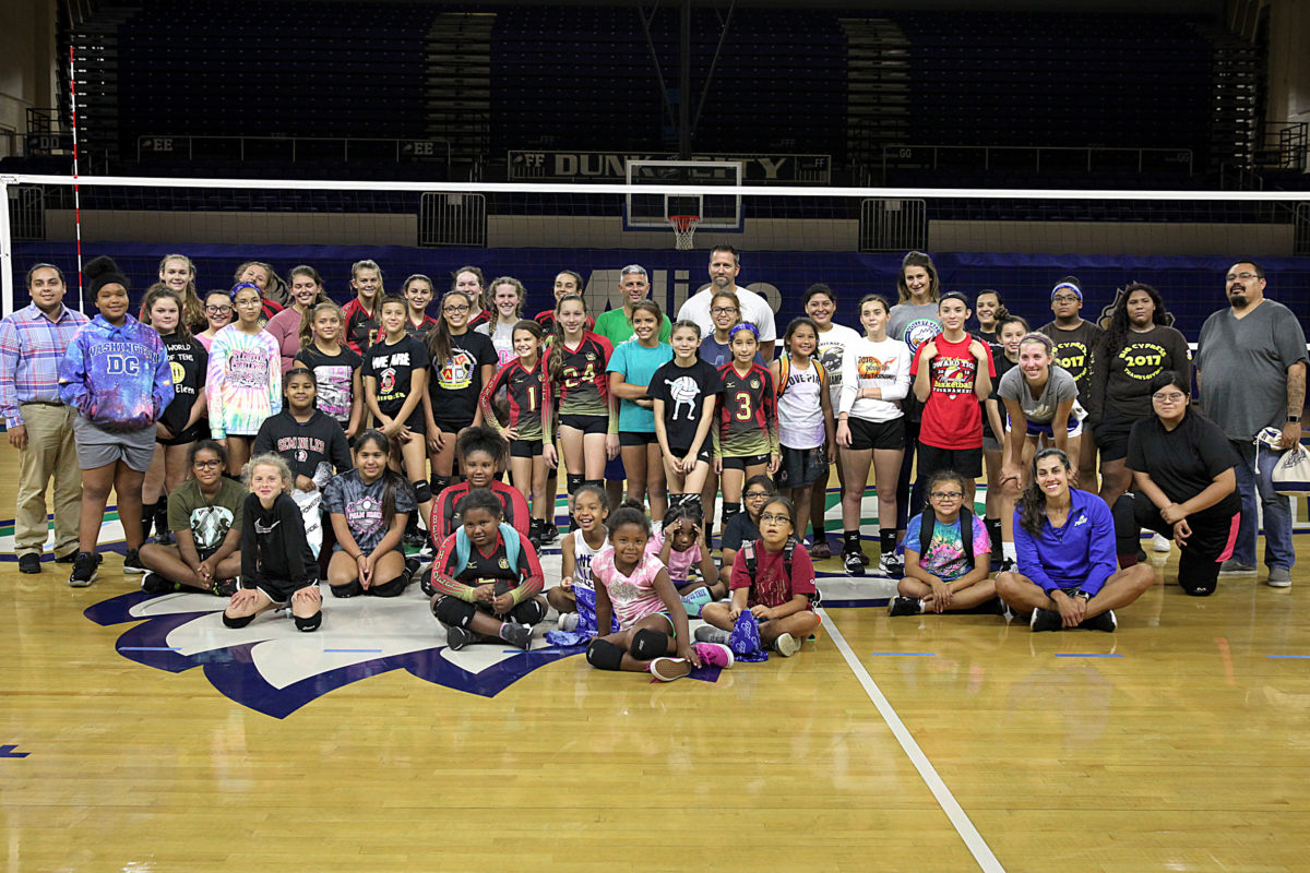Florida Gulf Coast University volleyball clinic participants and coaches gather on the court for a portrait June 9 at FGCU's Alico Arena in Fort Myers. Most of the players were from the Brighton and Big Cypress reservations. (Beverly Bidney photo)
