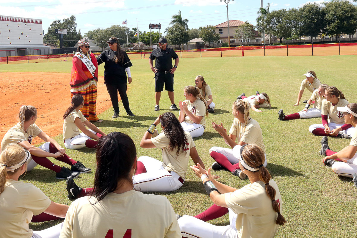 Jr. Miss Florida Seminole Thomlynn Billie speaks to the Florida State softball team after the Seminoles defeated Florida International University in a fall exhibition game Oct. 23, 2016, at Osceola Park on the Hollywood Reservation. (Kevin Johnson photo)
