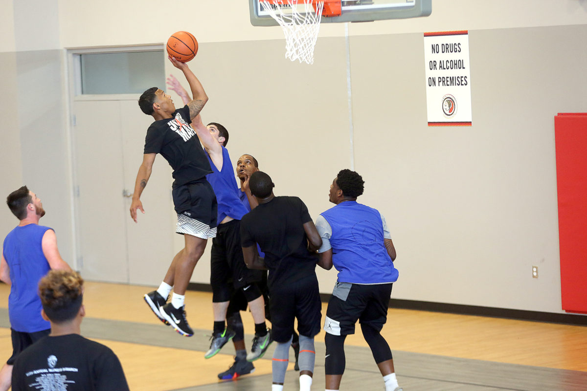 Biggie's Chayton York takes a one-handed jump shot amid traffic against We'll Be There at the Summer Slam in Fort Pierce.  (Kevin Johnson photo)