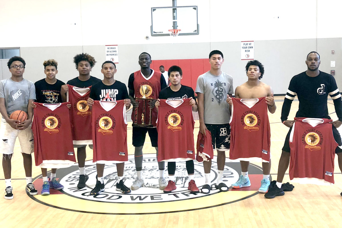 After going undefeated, the Biggie team shows off its prizes for winning the first Fort Pierce Reservation Summer Slam Shootout basketball tournament. (Photo courtesy Remus Griffin)