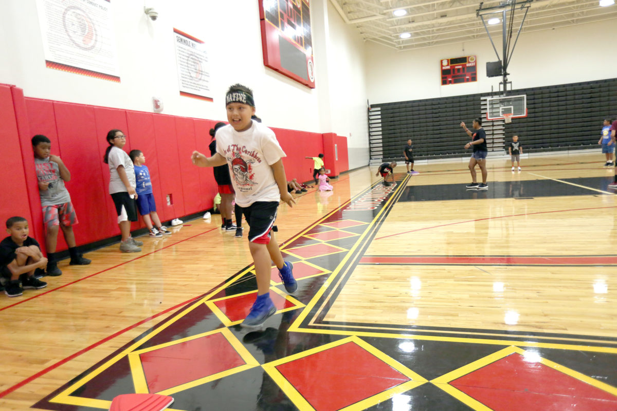 Christian Schaffer scores a run during the Hollywood sports camp kickball game June 20 at Howard Tiger Recreation Center.  (Kevin Johnson photo)