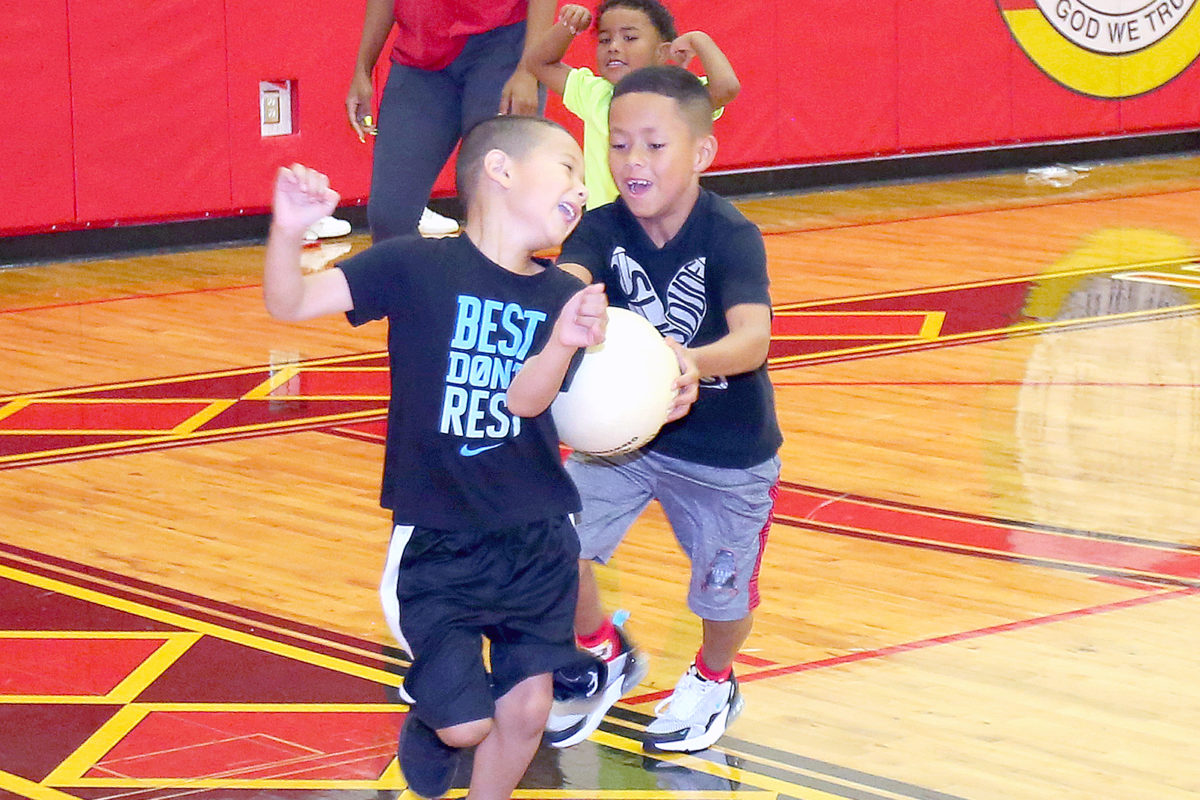 Carter Wilcox tags out Lakota Correa during the Hollywood sports camp kickball game. (Kevin Johnson photo)