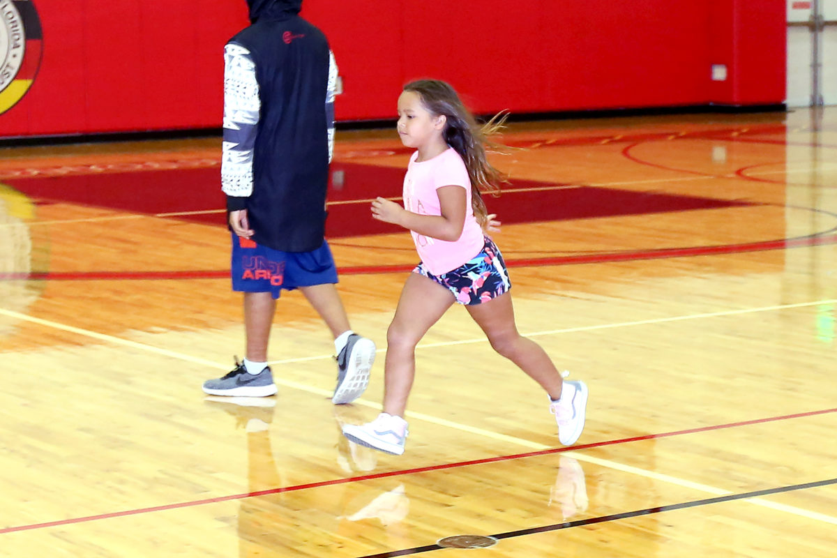 Dalina Rodriguez sprints to second base during a kickball game at the Howard Tiger Recreation Center.  (Kevin Johnson photo)