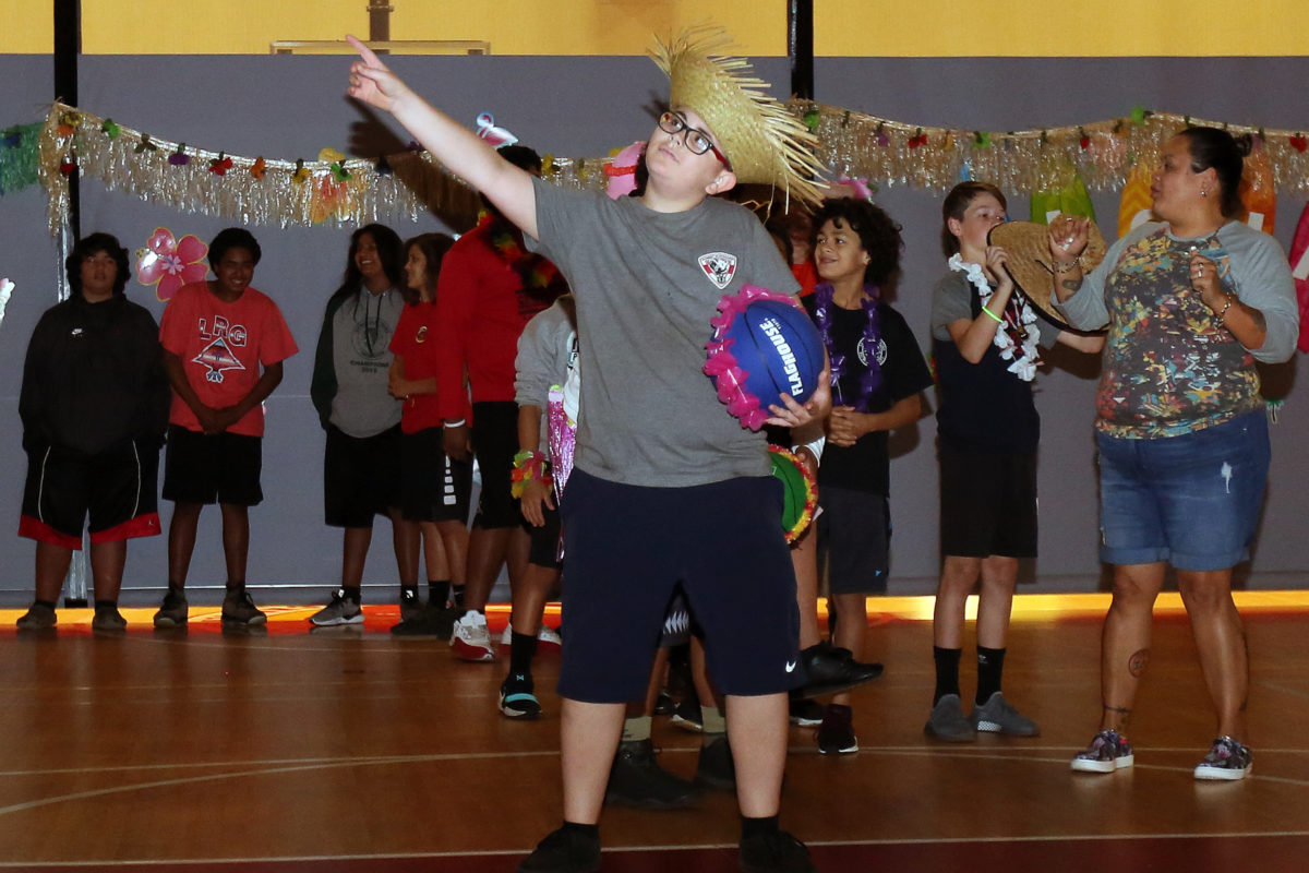 Sixth-grader Wyatt Thornton poses before taking his shot in the basketball competition. (Damon Scott photo)