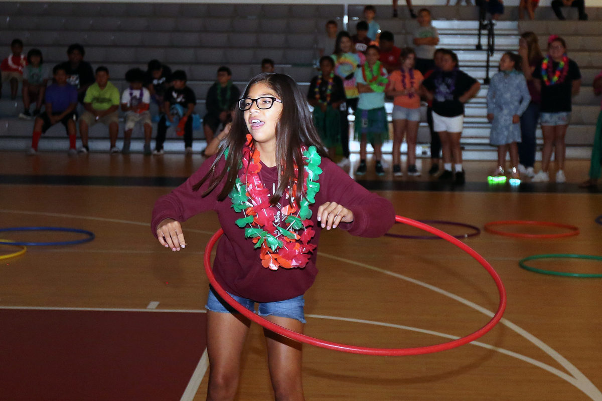 """Hula-hoops and leis don Tiyanni """"TT"""" Anderson as she nears the end of the competition. (Damon Scott photo)"""